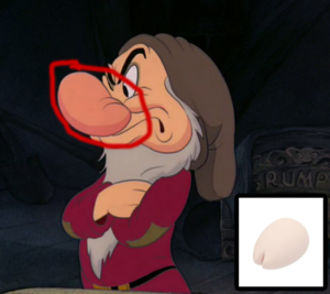 Screenshot from the Disney animated film Snow White showing Grumpy the dwarf with his nose circled and a photo of the Tenga Iroha Sakura in the bottom right corner